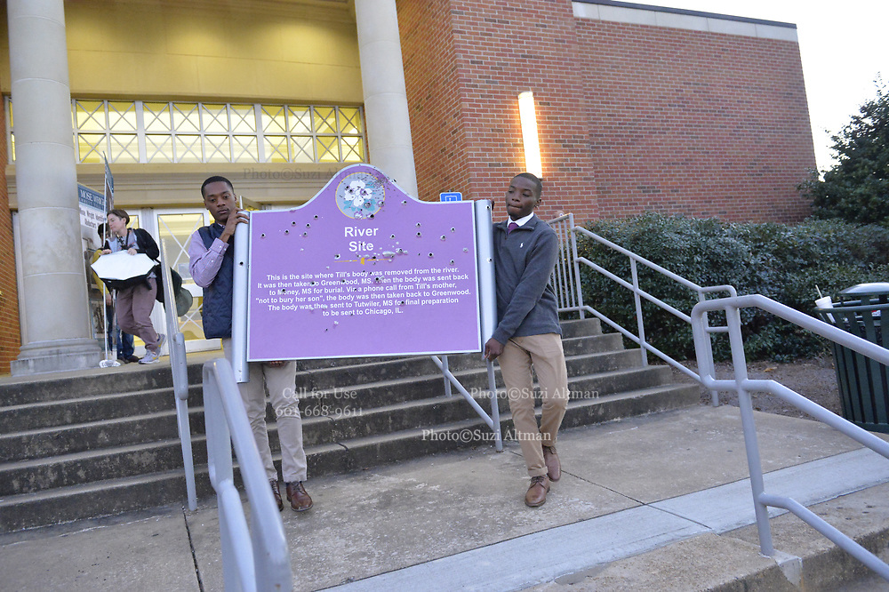 Students Tyler Yarbrough, left in vest and Curtis Hill both students at The University of Mississippi aka Ole Miss, carry the bullet ridden Emmett Till memorial sign onto campus by the Grove where the Confederate Statute has been on display for decades. They said they were doing this because the Confederate statute is an injustice and should be removed. Both students were part of a symposium earlier on campus as part of the Remembering Emmett Till event. Months earlier 3 white Ole Miss students shot up the sign the boys are carrying, it  was at Graball landing marking the site where the body of Emmett Till was removed from the Tallahatchie River and then the white Ole Miss students posted pictures on it in social media.Copyright ©Suzi Altman #till #injustice