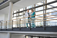 Physicians talking on Balcony