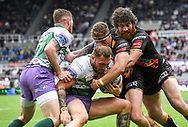 Josh Griffin of Hull Football Club  gets tackled by and Kyle Amor  and  Morgan Knowlesof Saint Helens during the Betfred Super League match on Magic Weekend at St. James's Park, Newcastle<br /> Picture by Melanie Allatt/Focus Images Ltd 07515 876011<br /> 20/05/2017