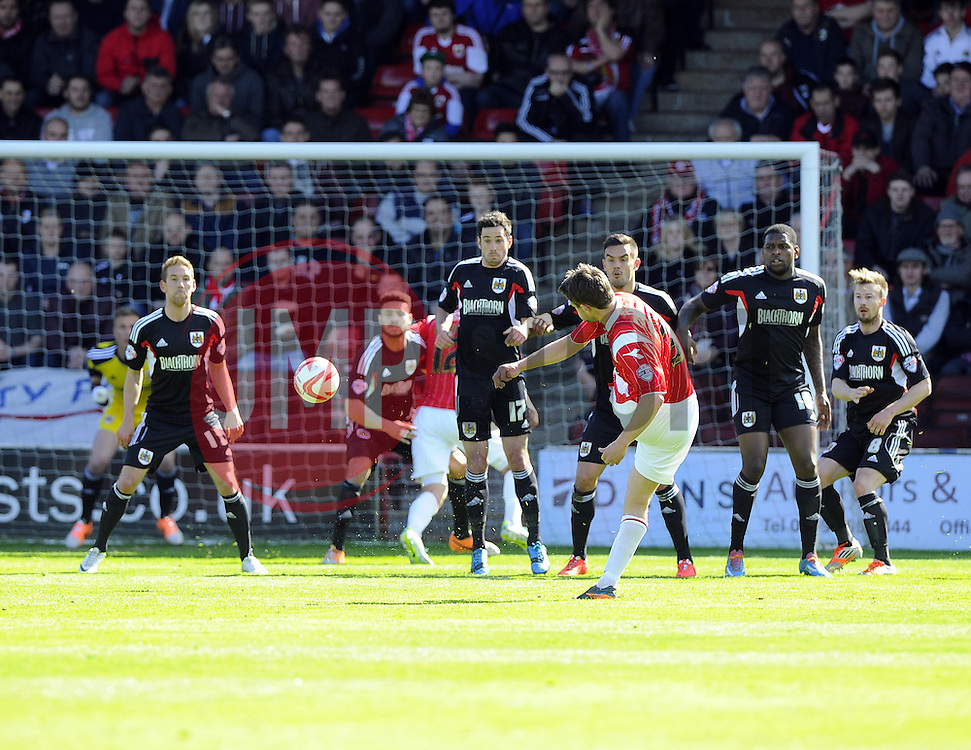 Walsall's Andy Taylor fires a free kick towards goal but its blocked by Bristol City's Scott Wagstaff  - Photo mandatory by-line: Joe Meredith/JMP - Mobile: 07966 386802 12/04/2014 - SPORT - FOOTBALL - Walsall - Banks' Stadium - Walsall v Bristol City - Sky Bet League One