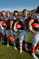 KELOWNA, BC - OCTOBER 6: Garrett Cape #2, Will Kuyvenhoven #43 and Sam Henneberry #30 of Okanagan Sun stands on the sidelines during the national anthem against the VI Raiders at the Apple Bowl on October 6, 2019 in Kelowna, Canada. (Photo by Marissa Baecker/Shoot the Breeze)