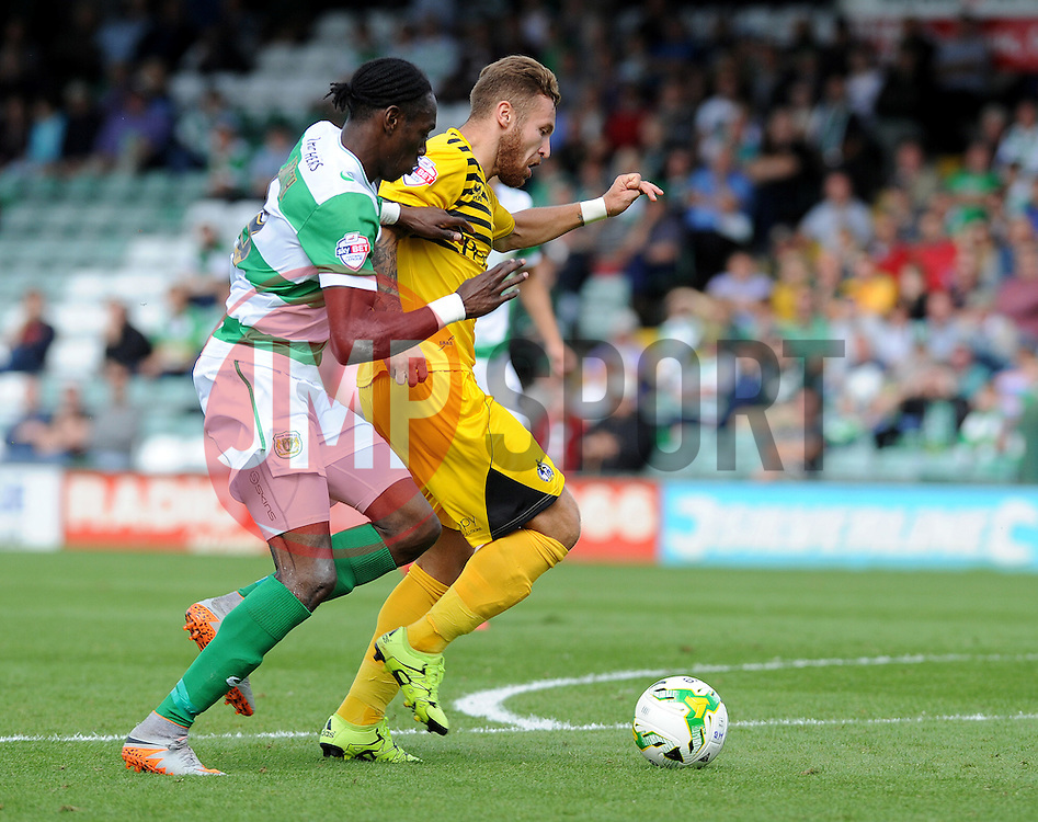 Matt Taylor of Bristol Rovers is challenged by Yeovil Town's Nathan Smith - Mandatory byline: Neil Brookman/JMP - 07966386802 - 15/08/2015 - FOOTBALL - Huish Park -Yeovil,England - Yeovi Town v Bristol Rovers - Sky Bet League One