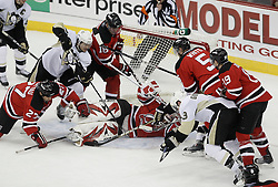 Dec 30, 2009; Newark, NJ, USA; New Jersey Devils goalie Martin Brodeur (30) makes a save during the third period at the Prudential Center. The Devils defeated the Penguins 2-0.