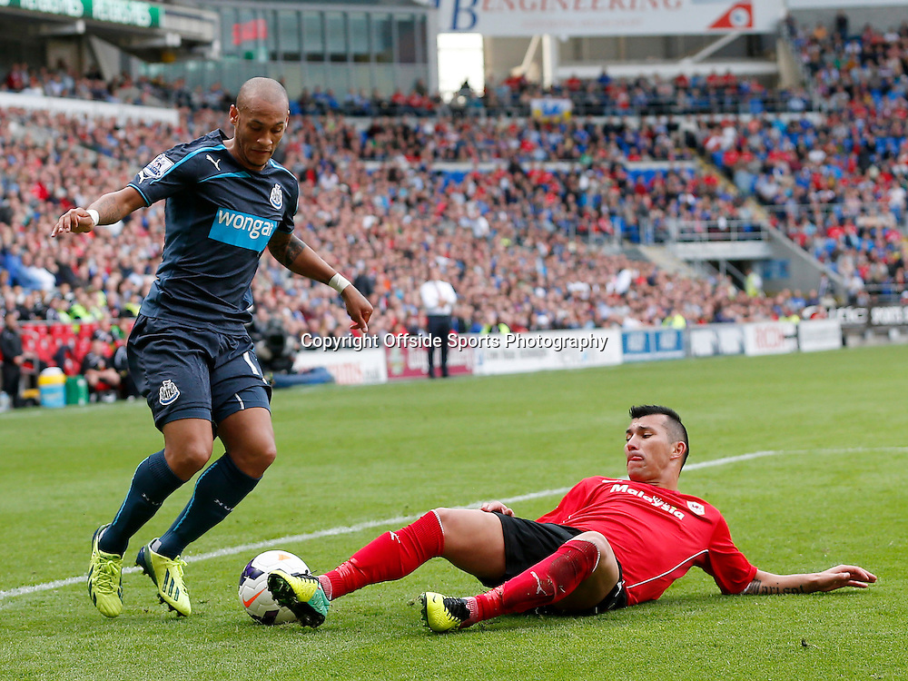 5th October 2013- Barclays Premier League - Cardiff City Vs Newcastle United - Gary Medel of Cardiff City dispossess Yoan Gouffran of Newcastle United as the midfielder surges into the box - Photo: Paul Roberts / Offside.