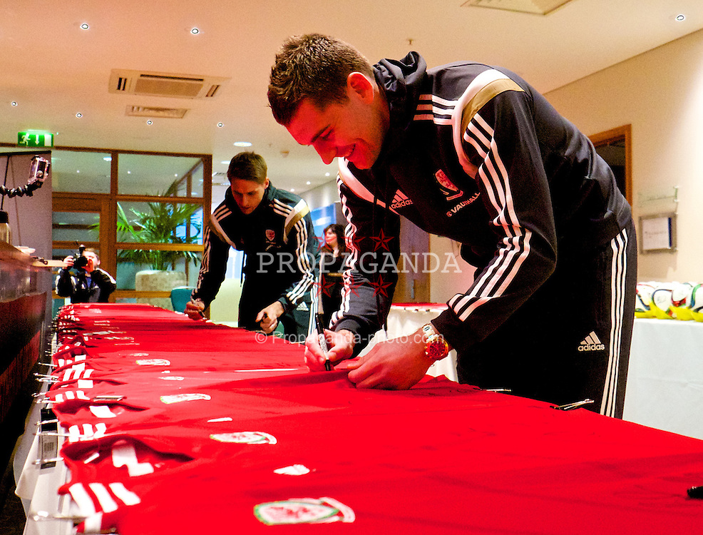 CARDIFF, WALES - Wednesday, March 25, 2015: Wales' Sam Vokes signs autographs at the Vale of Glamorgan ahead of the UEFA Euro 2016 qualifying Group B match against Israel. (Pic by David Rawcliffe/Propaganda)