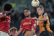 Michael Dawson (c) (Hull City) wins the header over Michael Mancienne (Nottingham Forest) during the Sky Bet Championship match between Hull City and Nottingham Forest at the KC Stadium, Kingston upon Hull, England on 15 March 2016. Photo by Mark P Doherty.