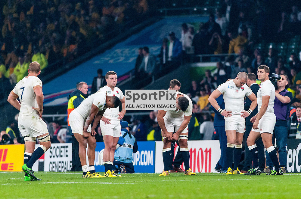 Dejected England players reflect on being knocked out of the Rugby World Cup. Action from the England v Australia game in Pool A of the 2015 Rugby World Cup at Twickenham in London, 3 October 2015. (c) Paul J Roberts / Sportpix.org.uk