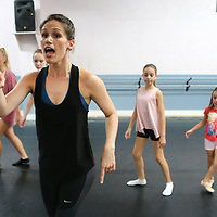 Alissa La Vergne, a Radio City Rockette, teaches a dance routine to a group of Tupelo girls at the North Mississippi Dance Centre's dance camp.