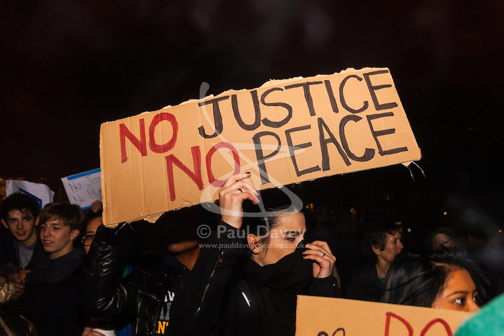 London, November 26th 2014. A vigil for teenager Mike Brown who was shot dead by a policeman in Ferguson, Missouri this year, takes place outside the US embassy in London. Anti-racism and human rights campaigners called the 'emergency' protest following a court verdict that clears Police Officer Darren Wilson of murder. PICTURED: Protest marchers leave the American embassy in Grosvenor Square before marching through the west end's Oxford Street.