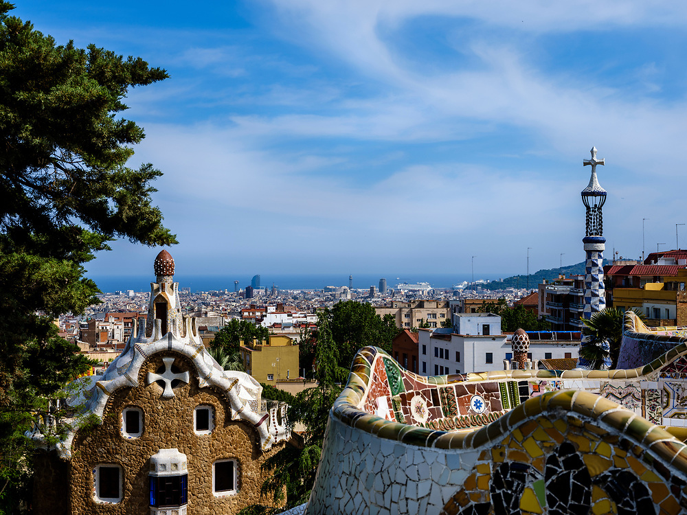 BARCELONA, SPAIN - CIRCA MAY 2018: View of Barcelona from Parc Güel. Parque Güell is a public park system composed of gardens and architectonic elements located on Carmel Hill, in Barcelona, Catalonia, Spain. It was designed by Antoni Gaudi and it is a popular tourist destination.