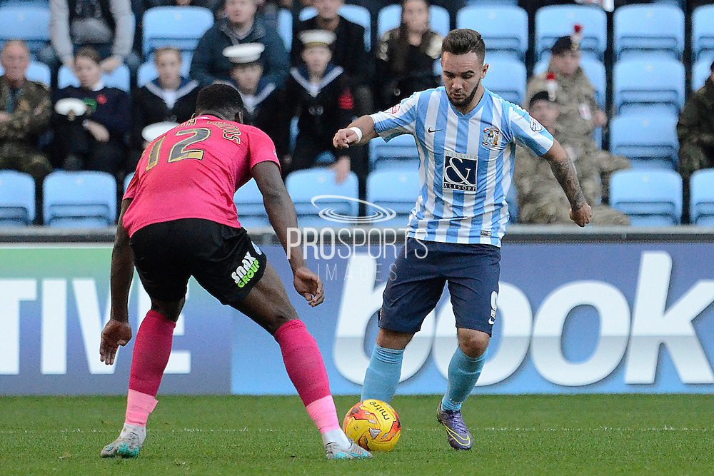 Coventry City striker Adam Armstrong takes on Peterborough United defender Ricardo Santos during the Sky Bet League 1 match between Coventry City and Peterborough United at the Ricoh Arena, Coventry, England on 31 October 2015. Photo by Alan Franklin.