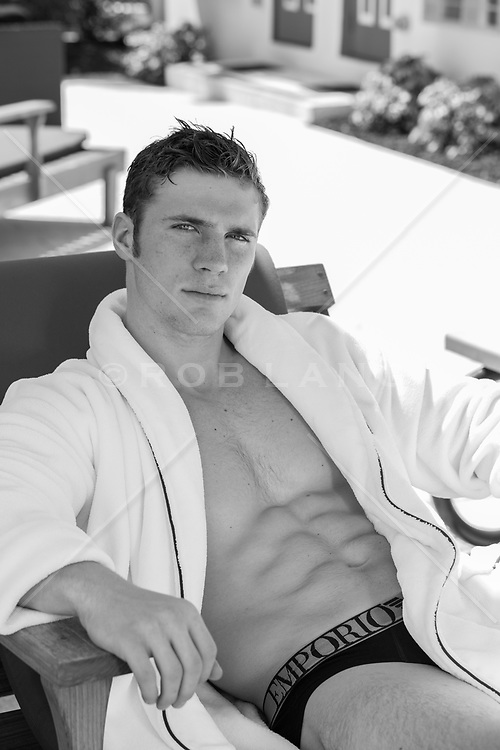 sexy man in an open robe outdoors