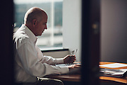 BIRMINGHAM, AL – MARCH 18, 2016: A white collar male executive works in an office environment.