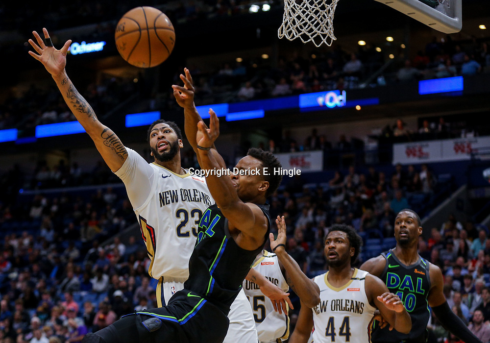 Mar 20, 2018; New Orleans, LA, USA; Dallas Mavericks guard Yogi Ferrell (11) passes as New Orleans Pelicans forward Anthony Davis (23) defends during the second quarter at the Smoothie King Center. Mandatory Credit: Derick E. Hingle-USA TODAY Sports