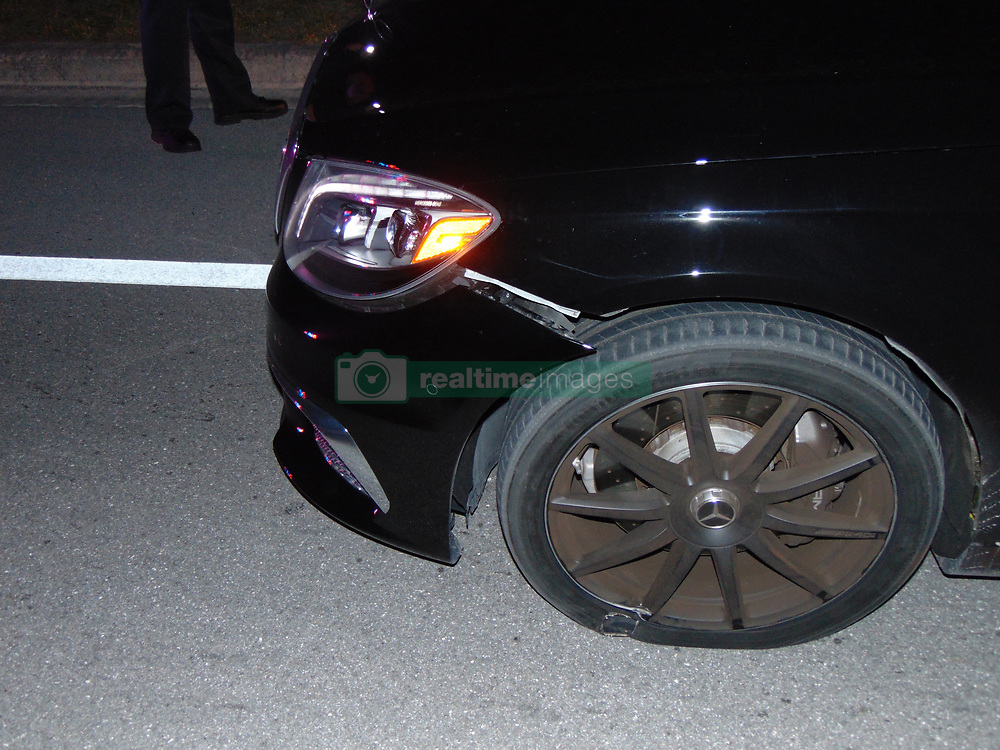 """Tiger Woods' smashed up car is seen here in images released by police from the golfer's DUI arrest earlier this week. The photos, released on May 31, show the sportsman's 2015 Mercedes Benz in a bad state - with two flat tires and cracking around the front bumper on the driver's side. According to the report by Jupiter Police, Woods was found asleep at the wheel of his car and was on four prescription drugs when he was arrested on suspicion of driving under the influence in the early hours of May 29 in Jupiter, Florida. He tested negative for alcohol. Elsewhere in the report it notes that Woods had 'extremely slow and slurred speech' and did not know where he was before taking the field tests. The golfer undertook four sobriety tests. After being asked to recite the alphabet backwards, he instead offered to recite the National Anthem backwards instead. During the Walk & Turn test the sportsman """"could not maintain starting position… missed heel to toe each time… stepped off the line several times… used arms for balance,"""" according to the arresting officer's report. He was also unable to perform the One Leg Stand, requiring him to lift one leg off the ground six inches, placing his foot down """"several times"""" while trying to complete the task. Woods was also seemingly confused by the Finger To Nose test, and was unable to complete the task as asked, the report notes. Woods released a statement later on May 29 in which he apologized. He insisted he hadn't taken alcohol but had suffered a reaction to prescription medication. 31 May 2017 Pictured: Tiger Woods 2015 Mercedes Benz - damage to car photographed after DUI arrest. Photo credit: Jupiter Police/ MEGA TheMegaAgency.com +1 888 505 6342"""