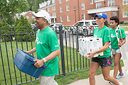 Ohio University President Roderick McDavis (Left) helps student move into their residence halls on East Green. Photo by Ben Siegel/ Ohio University