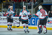 KELOWNA, CANADA - APRIL 8: Reid Gardiner #23, Dillon Dube #19 and Michael Herringer #30 of the Kelowna Rockets celebrate a second period goal against the Portland Winterhawks on April 8, 2017 at Prospera Place in Kelowna, British Columbia, Canada.  (Photo by Marissa Baecker/Shoot the Breeze)  *** Local Caption ***