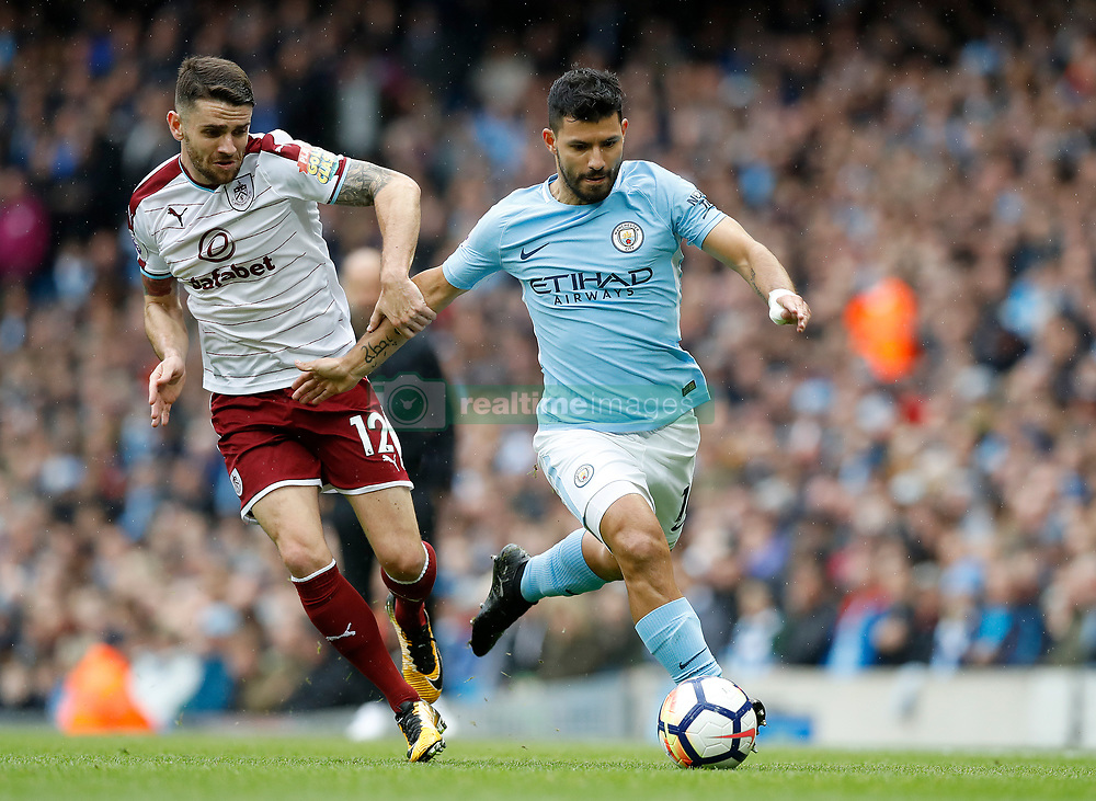 Burnley's Robbie Brady (left) and Manchester City's Sergio Aguero battle for the ball during the Premier League match at the Etihad Stadium, Manchester.
