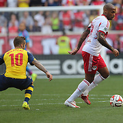 Thierry Henry, (right), New York Red Bulls, goes past Jack Wilshere, Arsenal, during the New York Red Bulls Vs Arsenal FC,  friendly football match for the New York Cup at Red Bull Arena, Harrison, New Jersey. USA. 26h July 2014. Photo Tim Clayton