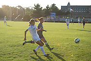 9/9/15 – Medford/Somerville, MA – As the sun sets over the Tufts goal, Tufts defender Stefanie Brunswick, A17, races to gain possession of the ball in the season opener against Lesley on Wednesday, Sep. 9, 2015. (Evan Sayles / The Tufts Daily)