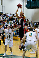 1/13/2006: Kendall Gielow of the Northwest Nazarene University Crusaders takes a shot in the Alaska Anchorage comeback victory over Northwest Nazarene, 60-57, in men?s basketball action at the Wells Fargo Sports Complex on Saturday.