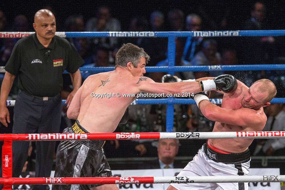 Brad `Hollywood` Pitt (L) fights Daniel Ammann in the Mahindra Super 8 Fight Night, North Shore Events Centre, Auckland, New Zealand, Saturday, November 22, 2014. Photo: David Rowland/Photosport