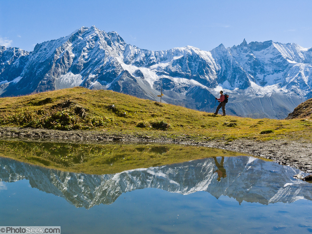 Les Dents des Veisivi (left) and Les Aiguilles de la Tsa (right) reflect in a pond above Arolla village, municipality of Evolène, Val d'Hérens, Valais (Wallis or Valley) canton, Switzerland, on the High Route (Chamonix-Zermatt Haute Route), in the Pennine Alps, Europe.
