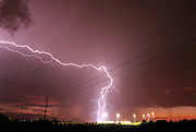 Lightning strikes during a monsoon storm strikes near a sports field in Tucson, Arizona, USA.