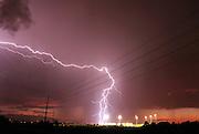 Lightning strikes during a monsoon storm strikes near a sports field in Tucson, Arizona, USA.