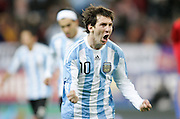 Argentina's Lionel Messi celebrates during the international friendly match between Spain and Argentina in Madrid, Spain on November 14 2009.