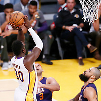 06 November 2016: Los Angeles Lakers forward Julius Randle (30) goes for the jump shot over Phoenix Suns forward Jared Dudley (3) and Phoenix Suns center Tyson Chandler (4) during the LA Lakers 119-108 victory over the Phoenix Suns, at the Staples Center, Los Angeles, California, USA.