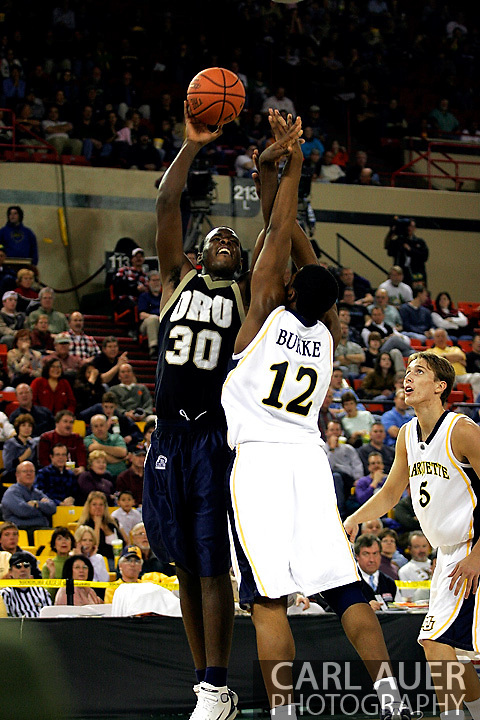25 November 2005: Caleb Green (30) takes a shot over Marquette Golden Eagle Dwight Burke (12) in the 70-73 loss to Marquette University at the Great Alaska Shootout in Anchorage, Alaska