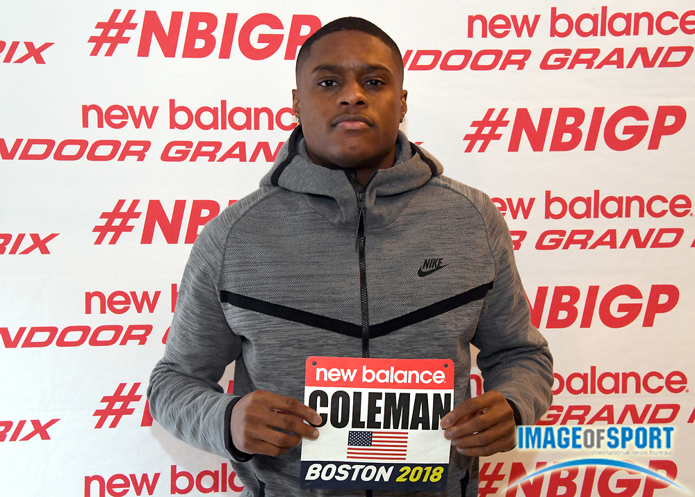 Christian Coleman poses with bib number during a  press conference prior to the New Balance Indoor Grand Prix in Boston on Friday, Feb. 9, 2018.