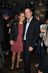 JAMIE MURRAY WELLS and LOTTIE FRY at a party to celebrate the opening of Bunga Bunga - a new Pizzeria & Bar, 37 Battersea Bridge Road, London SW11 on 1st September 2011.