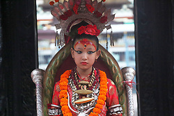 April 30, 2017 - Lalitpur, Nepal - Living Goddess Kumari observes the chariot procession of Rato Machhendranath,God of rain on the first day of the month-long festival from Pulchowk towards Gabhal.Rato Machhendranath is known as the god of rain and both Hindus and Buddhists worship for good rain to prevent drought during the rice harvest season. (Credit Image: © Archana Shrestha/Pacific Press via ZUMA Wire)