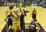 February 24 2011: Iowa Hawkeyes guard Kachine Alexander (21) puts up a shot over Illinois Fighting Illini forward Lana Rukavina (34) as Illinois Fighting Illini guard Amber Moore (42) looks on during the second half of an NCAA women's college basketball game at Carver-Hawkeye Arena in Iowa City, Iowa on February 24, 2011. Iowa defeated Illinois 83-64.