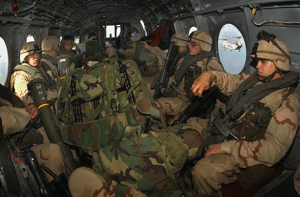 011214-N-2383B-5.ABOARD MARINE MEDIUM HELICOPTER SQUADRON-365  (December 14, 2001) -- U.S. Marines with the 26th Marine Expeditionary Unit (Special Operations Capable) take a ride in a CH-46E Sea Knight helicopter of Marine Medium Helicopter Squardon-365.  The Marines just deployed from the amphibious command ship USS Bataan (LHD 5) and are geared and ready for Afghanistan.  The Bataan Amphibious Ready Group is operating in support of Operation Enduring Freedom.  U.S. Navy photo by Chief Photographer's Mate Johnny Bivera, Fleet Combat Camera Atlantic (RELEASED).
