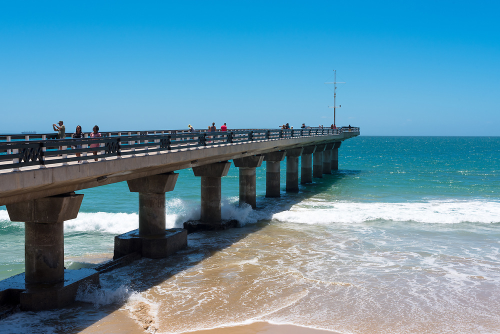 Port Elizabeth, South Africa--January 10, 2018  -- A pier juts into the warm waters of the Indian Ocean at Shark Rock Pier. Editorial Use Only.