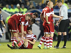 Middlesbrough's players show concern for Daniel Sanchez Ayala after he got the ball in his face- Photo mandatory by-line: Robin White/JMP - Tel: Mobile: 07966 386802 21/12/2013 - SPORT - FOOTBALL - The Den - Millwall - Millwall v Middlesbrough - Sky Bet Championship