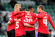 Exeter City's Ollie Watkins is congratulated by his team mates after giving the visitors a 1-0 lead during the Sky Bet League 2 match between Yeovil Town and Exeter City at Huish Park, Yeovil, England on 9 April 2016. Photo by Graham Hunt.