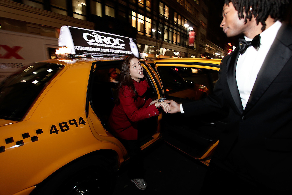 NEW YORK - DECEMBER 14:  A Ciroc street team member interact with a pedestrian during NYE Revelers Safe Rides Home on the streets of Manhattan on December 14, 2009 in New York City.  (Photo by Joe Kohen/Getty Images for Ciroc)