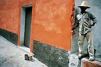 orange wall and its painter, Oaxaca, Mexico