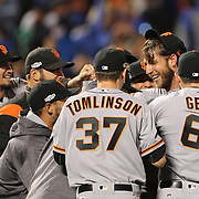 NEW YORK, NEW YORK - October 5: Pitcher Madison Bumgarner #40 of the San Francisco Giants is mobbed by team mates after his nine inning shut out during the San Francisco Giants Vs New York Mets National League Wild Card game at Citi Field on October 5, 2016 in New York City. (Photo by Tim Clayton/Corbis via Getty Images)