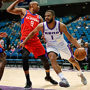 Reno Bighorns Guard AARON HARRISON (1) drives on the edge against Agua Caliente Clippers Guard CJ WILLIAMS (9) during the NBA G-League Basketball game between the Reno Bighorns and the Agua Caliente Clippers at the Reno Events Center in Reno, Nevada.