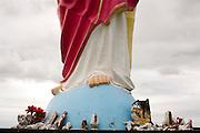 Monte Belo_MG, Brasil...Escultura de jesus Cristo, em Monte belo, e santos quebrados nos seus pes, segundo a superticao, santo quebrado em casa da azar...Jesus Christ sculpture, in Monte Belo, and broken saints in his feet. According to superstition, broken saint into the house is bad luck...Foto: LEO DRUMOND / NITRO