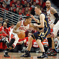 16 April 2011:  Chicago Bulls point guard Derrick Rose (1) drives past Indiana Pacers power forward Tyler Hansbrough (50) during the Chicago Bulls 104-99 victory over the Indiana Pacers, during the game 1 of the Eastern Conference first round at the United Center, Chicago, Illinois, USA.