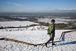 © Licensed to London News Pictures. 30/01/2019. Butlers Cross, UK.  A walker looks over a snow covered landscape on Coombe Hill in Butlers Cross, Buckinghamshire, as snow hits the south east of England. Photo credit: Ben Cawthra/LNP