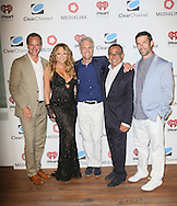 CAP D'ANTIBES, FRANCE - JUNE 17:  Tom Poleman, President of Programming, Clear Channel, Mariah Carey, John Sykes, President of Entertainment Enterprises, Clear Channel, Michael Kassan, CEO of MediaLink, Greg Glenday – President of Connections, Clear Channel attend Clear Channel Media And Entertainment And MediaLink Dinner at Hotel du Cap-Eden-Roc on June 17, 2014 in Cap d'Antibes, France.  (Photo by Tony Barson/Getty Images for Clear Channel)