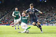 Ross County Defender Richard Foster stopped on the run by a vital tackle during the Scottish League Cup Final match between Hibernian and Ross County at Hampden Park, Glasgow, United Kingdom on 13 March 2016. Photo by Craig McAllister.