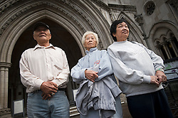 © London News Pictures. 08/05/2012. London, UK. L to R Loh Ah Choi, Lim Ah Yin and Chong Koon Ying, Family of Malaysians killed by British soldiers arriving at The High Court in London on May 08, 2012. The Family members of 24 villagers killed by UK troops  when Malaya was part of the British Empire are seeking an inquiry into their deaths which they claim were 'cold-blooded mass murder'. The judicial review is to be held on 8th and 9th of May. Photo credit: Ben Cawthra/LNP